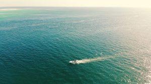Anna Maria Island drone shot of a power boat